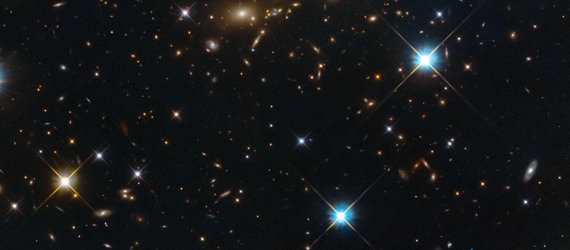 Ammasso di galassie PLCK G308.3-20.2 nella costellazione Uccello del Paradiso. - Sputnik Italia, 1920, 12.02.2019