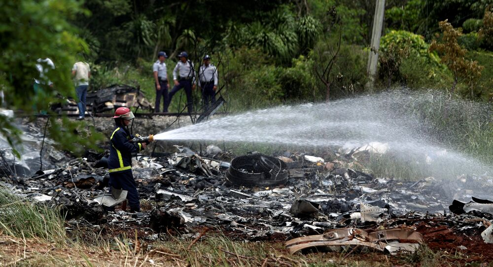 Firefighters work in the wreckage of a Boeing 737 plane that crashed in the agricultural area of Boyeros, around 20 km (12 miles) south of Havana, shortly after taking off from Havana's main airport in Cuba, May 18, 2018.