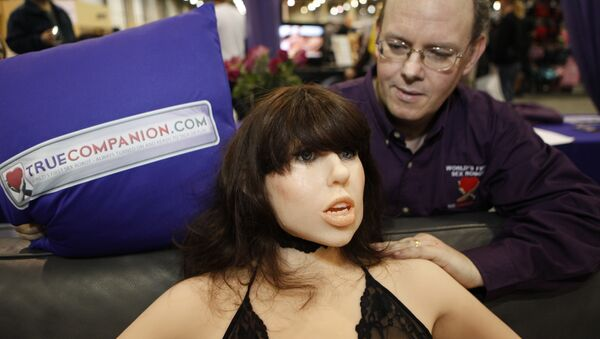 Douglas Hines, founder of True Companion, poses with a life-size rubber doll named Roxxxy during the Adult Entertainment Expo in Las Vegas, Saturday, Jan. 9, 2010. - Sputnik Italia