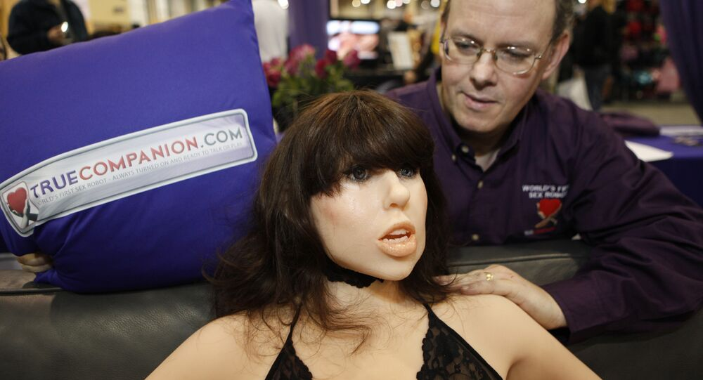 Douglas Hines, founder of True Companion, poses with a life-size rubber doll named Roxxxy during the Adult Entertainment Expo in Las Vegas, Saturday, Jan. 9, 2010.