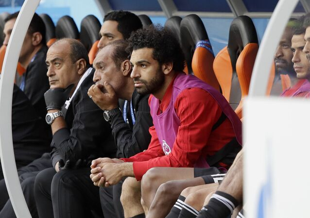Egypt's Mohamed Salah, center, watches his team during the group A match between Egypt and Uruguay at the 2018 soccer World Cup in the Yekaterinburg Arena in Yekaterinburg, Russia, Friday, June 15, 2018