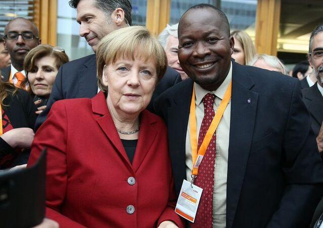 Robert Atangana e Angela Merkel