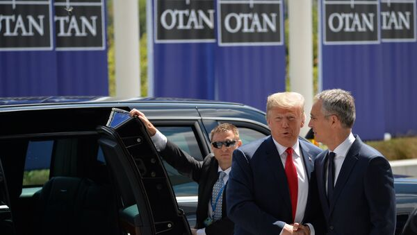 US President Donald Trump (L) and NATO Secretary General Jens Stoltenberg (R) are shaking hands at the meeting of NATO Heads of State and Government in Brussels, Belgium on 11 July 2018 - Sputnik Italia