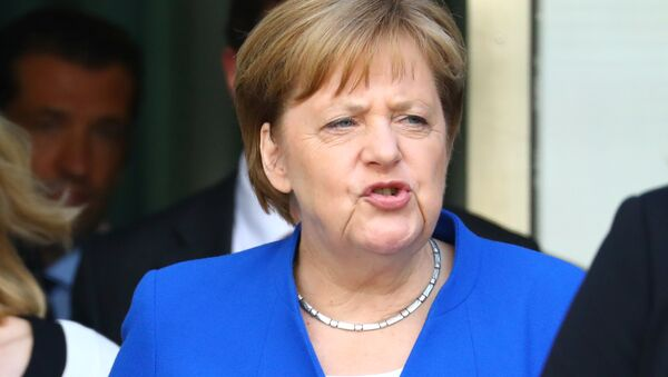 German Chancellor Angela Merkel leaves a CDU/CSU fraction meeting in Berlin, Germany, July 2, 2018 - Sputnik Italia