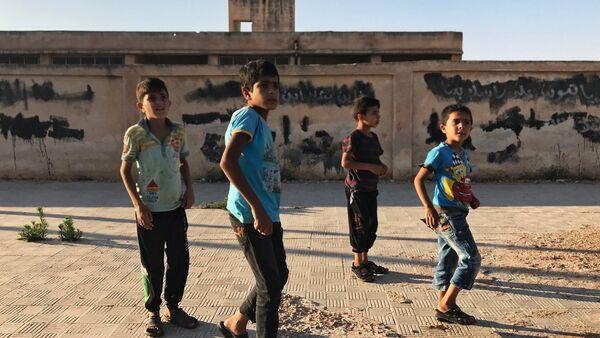 I piccoli abitanti della località di Alma nella prov incia di Deraa in Siria. - Sputnik Italia