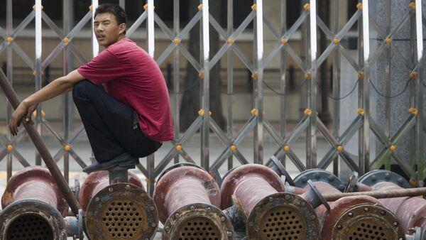 Uomo cinese su un camion - Sputnik Italia
