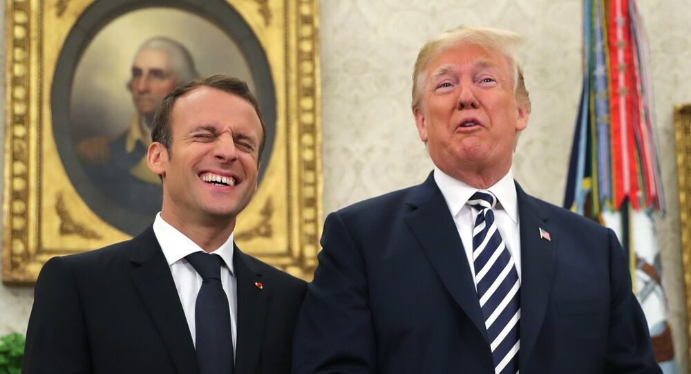 President Donald Trump and French President Emmanuel Macron talk to the media at the beginning or their in Oval Office of the White House in Washington, Tuesday, April 24, 2018.