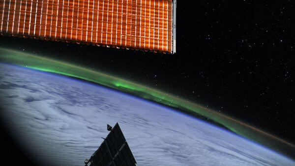 Полярное сияние с борта Международной космической станции - Sputnik Italia