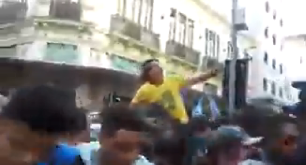 Brazilian far-right presidential candidate Jair Bolsonaro in a parade September 6, 2018, moments before being stabbed in the abdomen with a knife by a bystander