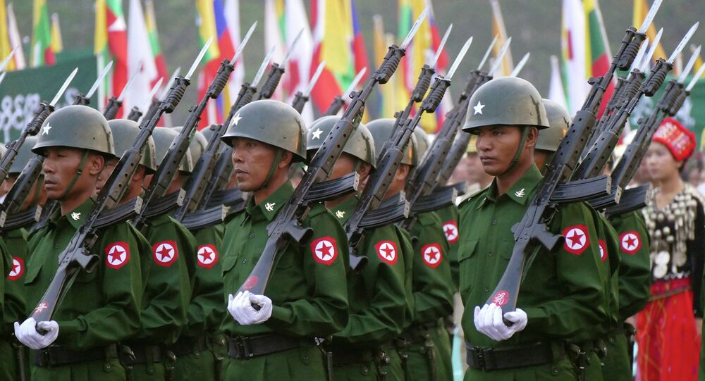 Myanmar soldiers stand to salute the national flag during a ceremony to mark the 68th anniversary of Union Day at public square in Yangon, Myanmar Thursday, Feb. 12, 2015.