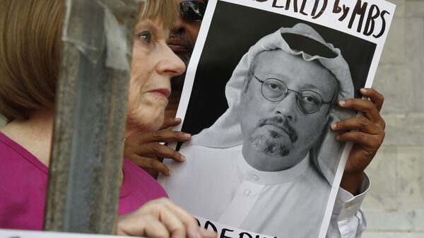 People hold signs during a protest at the Embassy of Saudi Arabia about the disappearance of Saudi journalist Jamal Khashoggi, Wednesday, Oct. 10, 2018, in Washington. - Sputnik Italia