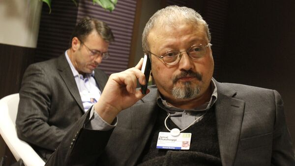Saudi journalist Jamal Khashoggi speaks on his cellphone at the World Economic Forum in Davos, Switzerland. Khashoggi was a Saudi insider. He rubbed shoulders with the Saudi royal family and supported its efforts to nudge the entrenched ultraconservative clerics to accept reforms. He was a close aide to the kingdom's former spy chief and was a leading voice in the country's prominent dailies - Sputnik Italia