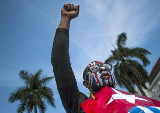 A Papuan rises his fist as he displays Morning Star separatist flags during a protest commemorating the 50th year since Indonesia took over West Papua from Dutch colonial rule in 1963, in Yogyakarta, Indonesia, May 1, 2013.