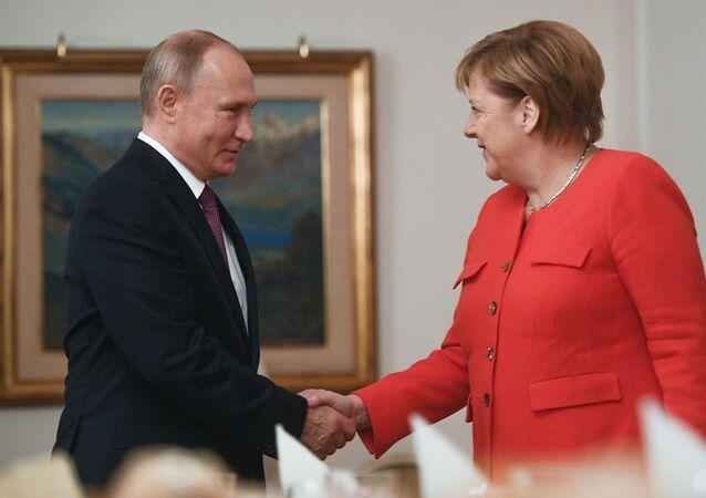 G20, Vladimir Putin con Angela Merkel