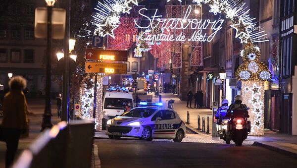 A police car drives in the streets of Strasbourg, eastern France, after a shooting breakout, on December 11, 2018 - Sputnik Italia