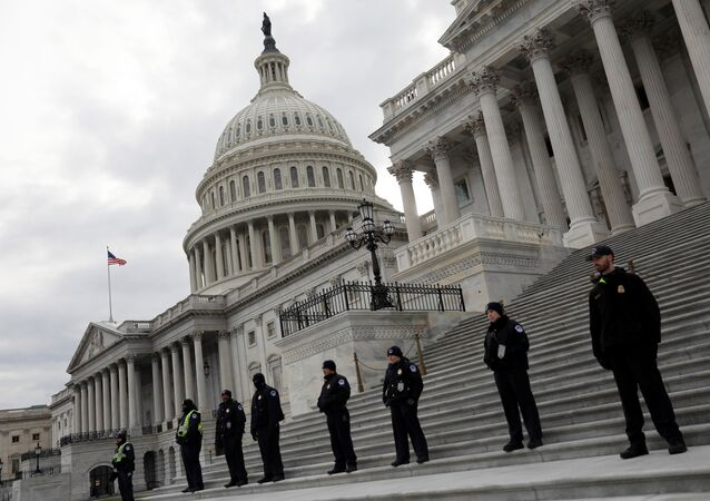 Capitol Hill Police officers look on as activists gather at the US Capitol to protest President Donald Trump's executive actions on immigration in Washington January 29, 2017