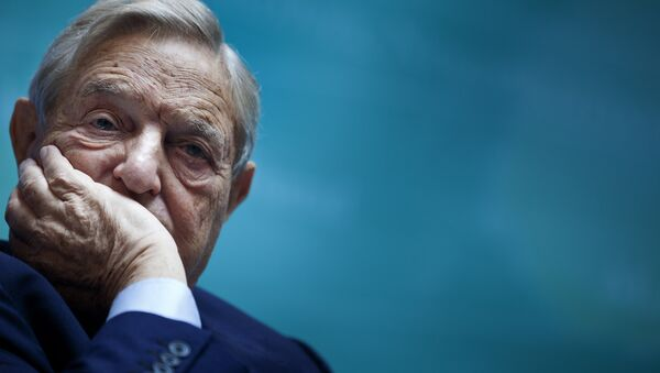 George Soros, Chairman of Soros Fund Management, listens during a seminar titled Charting A New Growth Path for the Euro Zone at the annual International Monetary Fund and World Bank meetings September 24, 2011 in Washington, DC. - Sputnik Italia