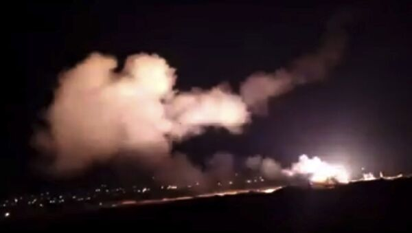 This frame grab from a video provided by the Syrian official news agency SANA shows missiles flying into the sky near Damascus, Syria, Tuesday, Dec. 25, 2018 - Sputnik Italia