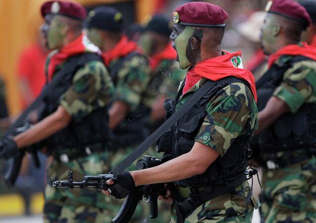 Soldiers march during a military parade commemorating the 20th anniversary of the failed coup attempt by President Hugo Chavez in Caracas, Venezuela