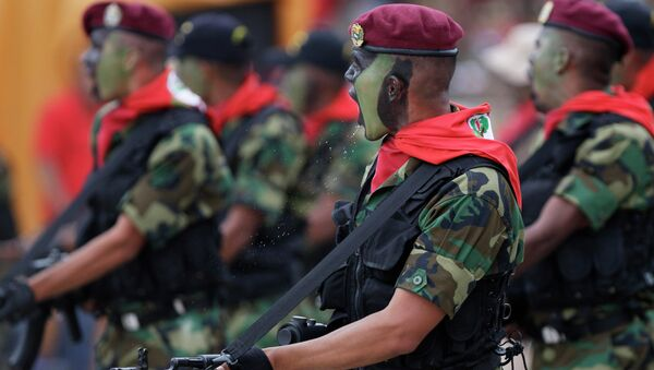 Soldiers march during a military parade commemorating the 20th anniversary of the failed coup attempt by President Hugo Chavez in Caracas, Venezuela - Sputnik Italia