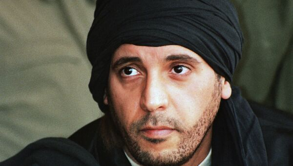 In this undated file photo made available Sept. 25, 2011, Hannibal Gadhafi, son of ousted Libyan leader Moammar Gadhafi, watches an elite military unit exercise in Zlitan, Libya. - Sputnik Italia