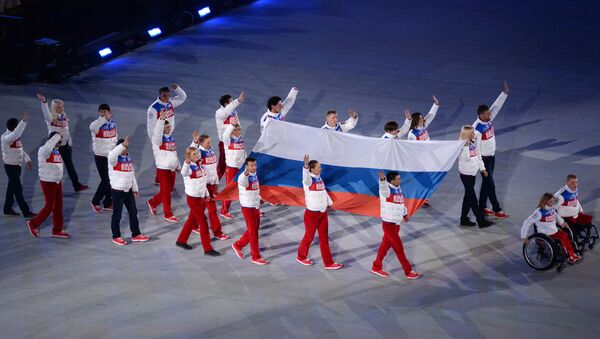 The Russian national flag carried out at the closing ceremony of the Sochi 2014 Winter Paralympics. (File) - Sputnik Italia