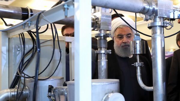 President Hassan Rouhani listens to explanations on new nuclear achievements at a ceremony to mark National Nuclear Day, in Tehran, Iran, Monday, April 9, 2018 - Sputnik Italia