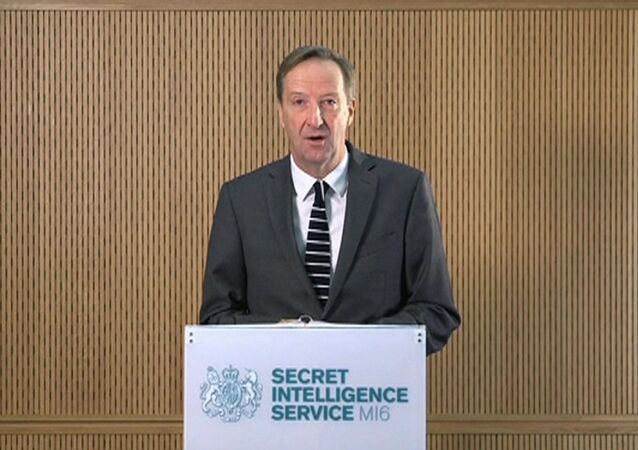 MI6 chief Alex Younger speaks at MI6's Vauxhall Cross headquarters in central London, in this still image from video, Britain December 8, 2016.