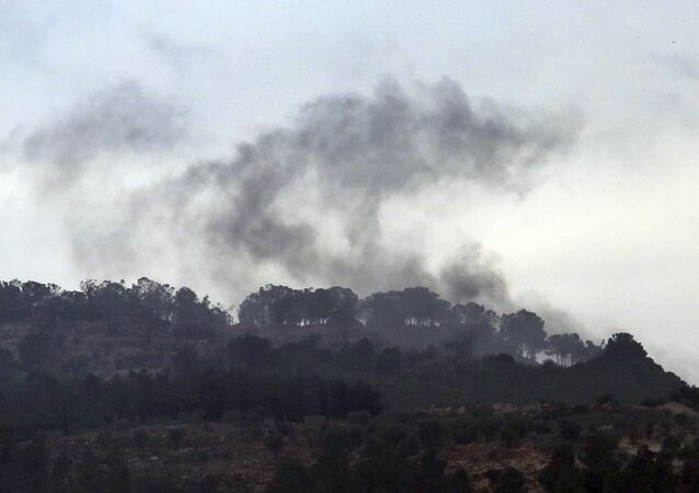 Smoke rises from inside Syria during shelling from Turkish forces, as seen from the Oncupinar border crossing with Syria, known as Bab al Salameh in Arabic, in the outskirts of the town of Kilis, Turkey, Friday, Jan. 26, 2018