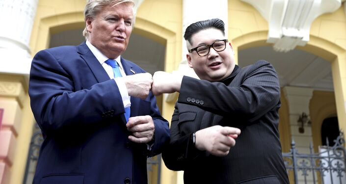 U.S. President Donald Trump impersonator Russell White, left, and Kim Jong-un impersonator Howard X pose for photos outside the Opera House in Hanoi, Vietnam, Friday, Feb. 22, 2019. The second summit between Trump and Kim will take place in Hanoi on Feb. 27 and 28.