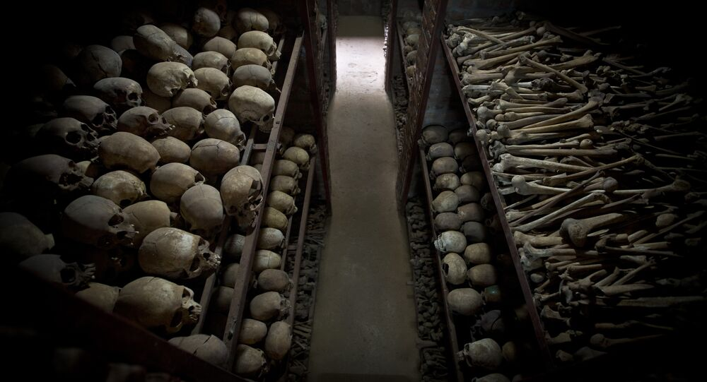 The skulls and bones of some of those who were slaughtered as they sought refuge inside the church, are laid out on shelves in an underground vault as a memorial to the thousands who were killed in and around the Catholic church during the 1994 genocide in Nyamata, Rwanda, Friday, April 4, 2014