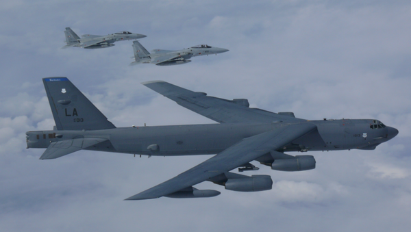 A B-52H Stratofortress bomber aircraft integrated with the Koku Jieitai (Japan Air Self Defense Force) while conducting a routine training mission in the East China Sea and Sea of Japan Sep. 26, 2018  - Sputnik Italia
