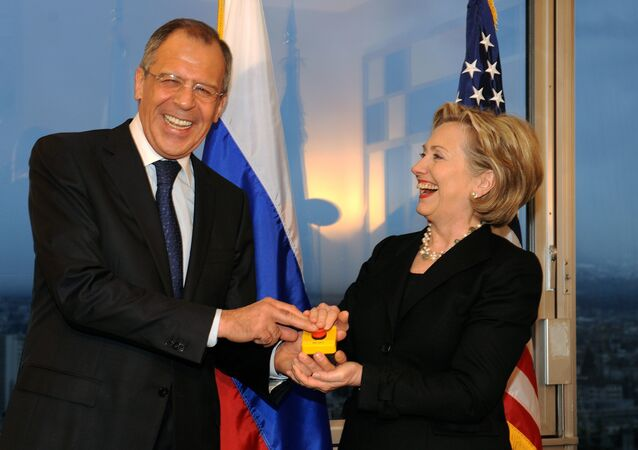 US Secretary of State Hillary Clinton (R) smiles with Russian Foreign Minister Sergei Lavrov after she gave him a device with red knob during a meeting on March 6, 2009 in Geneva.