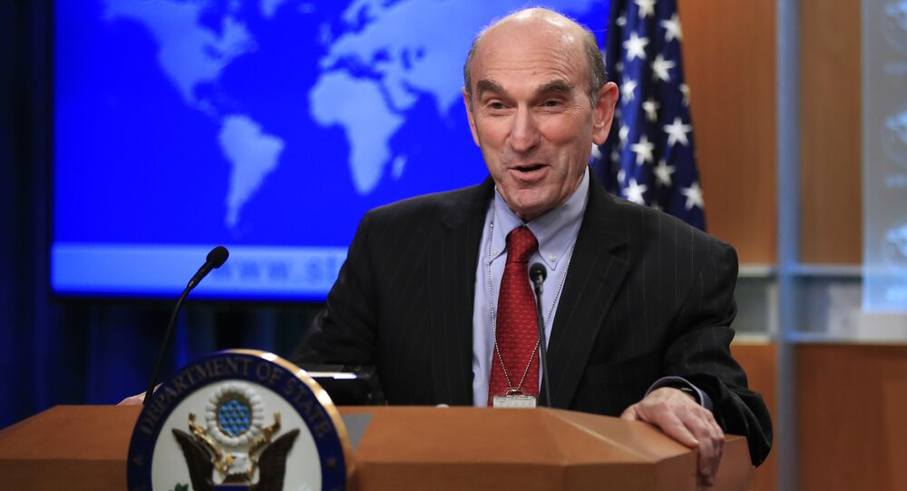 Elliott Abrams talks to reporters after Secretary of State Mike Pompeo named the hawkish former Republican official to handle U.S. policy toward Venezuela during a news conference at the State Department in Washington, Friday, Jan. 25, 2019