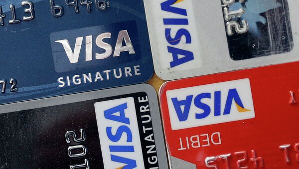 In this April 25, 2013 file photo, credit and debit cards are displayed for a photographer in Baltimore. Visa Inc. reports quarterly earnings on Thursday, April 24, 2014 - Sputnik Italia