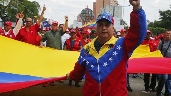 Marcia in sostegno al presidente Nicolas Maduro a Caracas, Venezuela. - Sputnik Italia