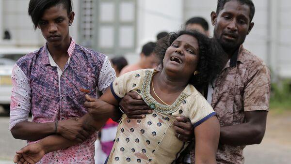 Parenti degli uccisi a seguito delle esplosioni in Sri Lanka - Sputnik Italia
