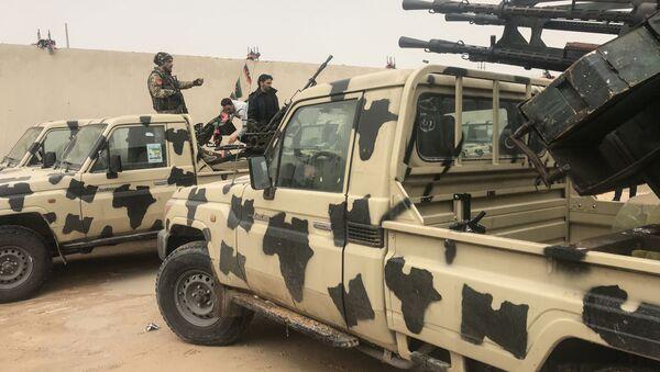 Транспорт, захваченный отрядами Халифы Хафтара в прибрежном городе Завия, к западу от Триполи, Ливия - Sputnik Italia