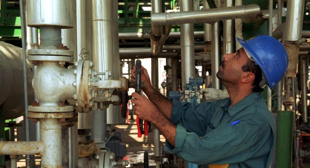 An Iranian works at a petrochemical plant in the Gulf port of Bandar Khomeini in southwestern Iran