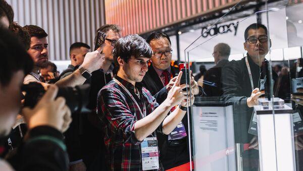 Lo stand Huawei alla mostra tecnologica annuale Mobile World Congress 2019 a Barcellona - Sputnik Italia