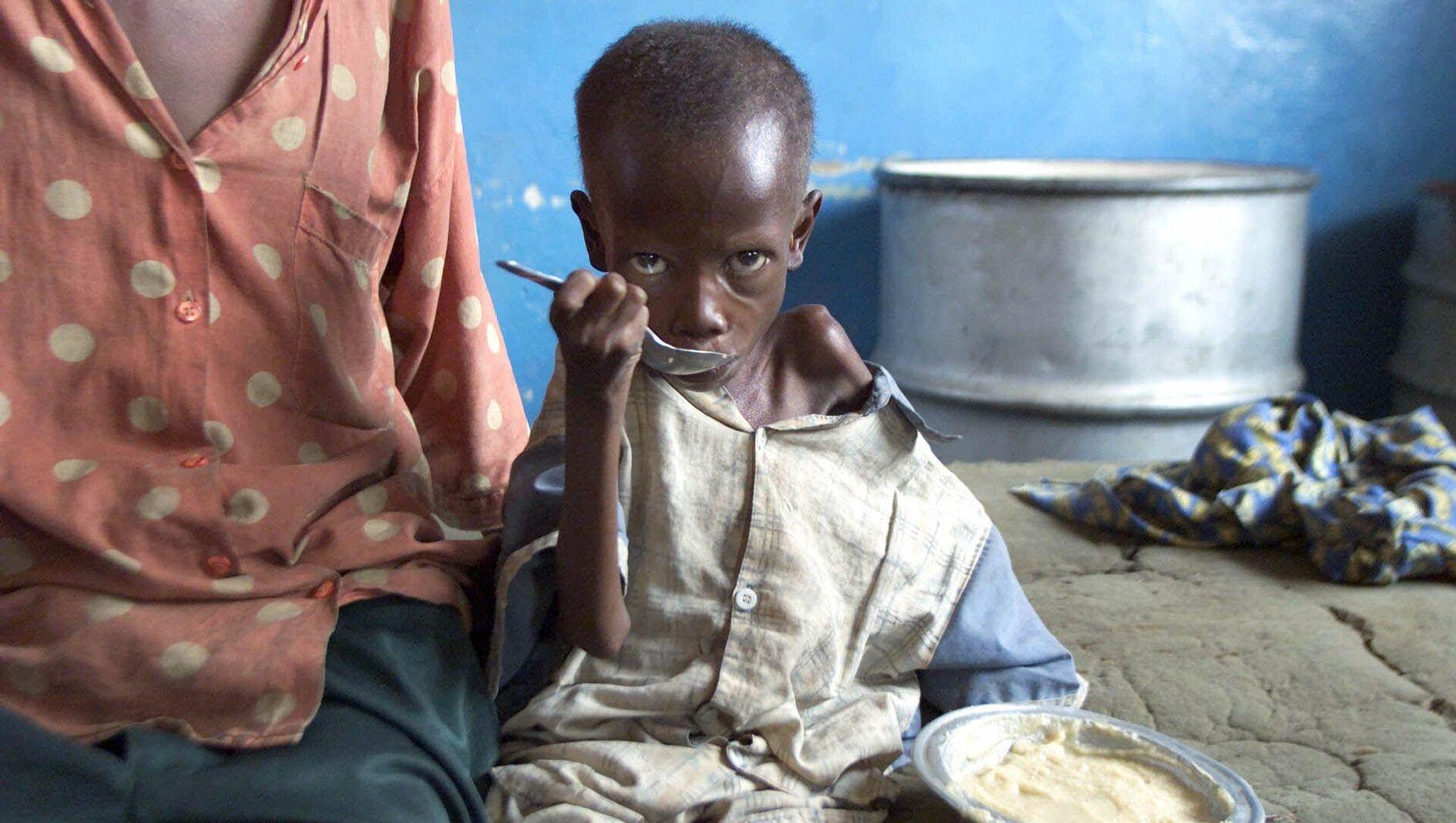 Bambino consumato dalla fame in Congo - Sputnik Italia, 1920, 22.02.2021