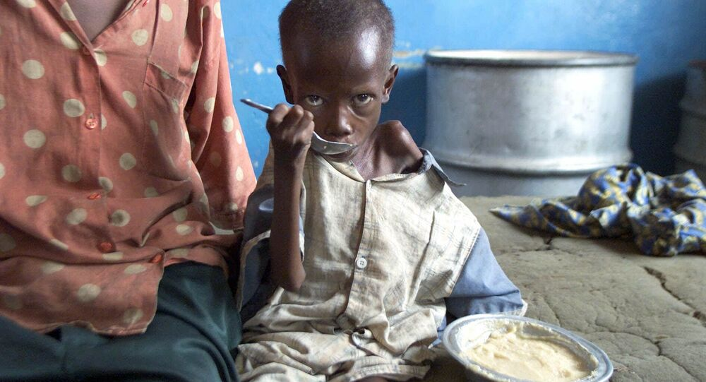 Bambino consumato dalla fame in Congo