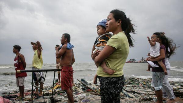 La foto intitolata La guardia costiera scattata dal fotografo filippino Basilio Sepe, divenuto finalista della categoria Notizie principali, foto singole. - Sputnik Italia