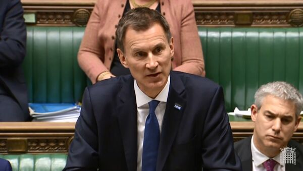 A video grab from footage broadcast by the UK Parliament's Parliamentary Recording Unit (PRU) shows Britain's Health and Social Care Secretary Jeremy Hunt speaking during the Opposition Day Debate: NHS Winter Crisis session in the House of Commons in central London on January 10, 2018 - Sputnik Italia