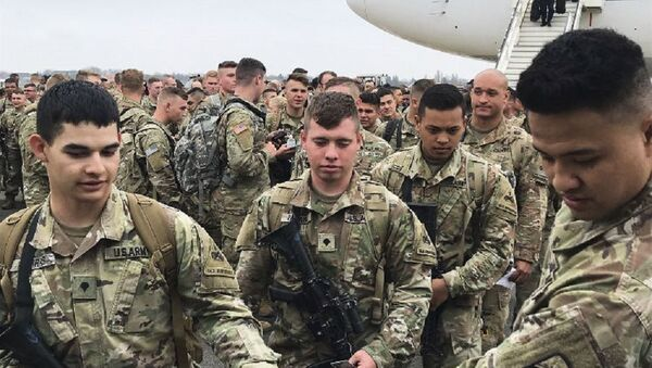 Soldiers from the 1st Armored Division, based in Fort Bliss, Texas, arrives at the airport Tegel in Berlin, Thursday, March 21, 2019 - Sputnik Italia