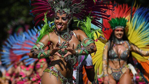 Il carnevale di Notting Hill a Londra. L'evento è dedicato alla cultura caraibica ed è considerato il più grande festival di strada in Europa. - Sputnik Italia
