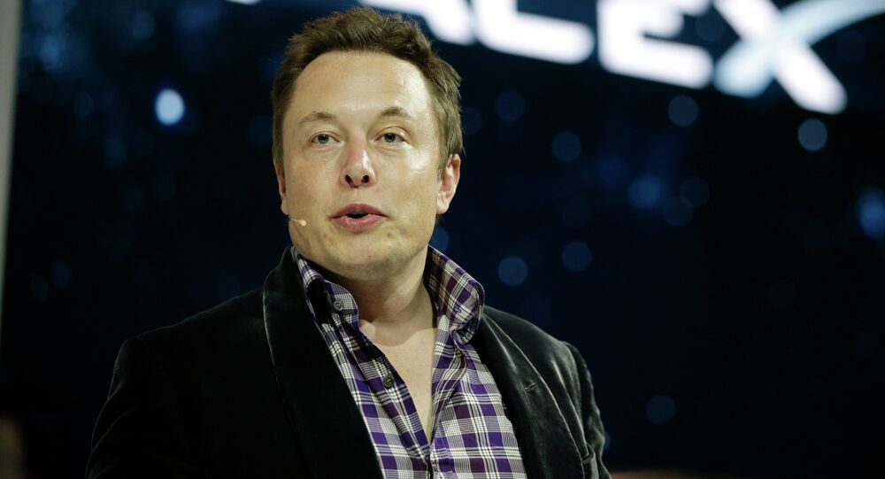 In this May 29, 2014 file photo, Elon Musk, CEO and CTO of SpaceX, introduces the SpaceX Dragon V2 spaceship at the SpaceX headquarters in Hawthorne, Calif. The state of Texas and SpaceX have announced that the California-based company will build the first commercial launch site for orbital launches in the southernmost tip of Texas.