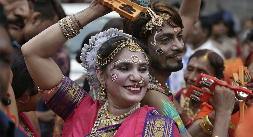 Indian Hindu devotees participate in the annual festival of Rath Yatra, or chariot procession, in Ahmadabad, India, Thursday, July 4, 2019