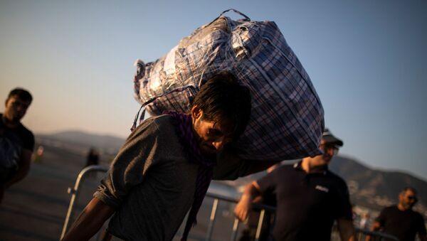 Migrante afghano in Grecia - Sputnik Italia