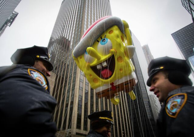 The Spongebob Squarepants balloon floats by New York Police Officers during the 88th Annual Macy's Thanksgiving Day Parade in New York November 27, 2014
